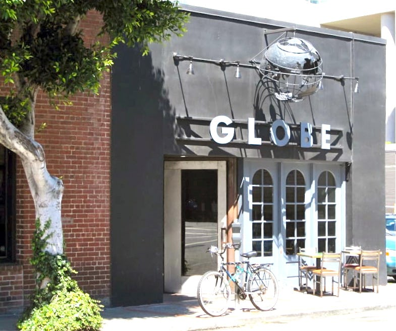 Globe restaurant builtform construction dining outside steel facade